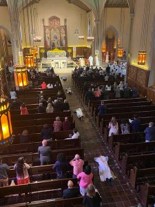 View of the University Church from the choir loft; four priests can be seen lying face down in the center aisle during the Litany of the Saints ceremony