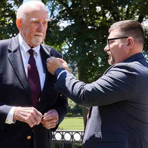 Lenehan recieves Ram Veteran Lapel Pin from Matt Butler