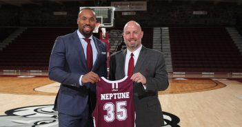 Athletic director Ed Kull, right, posing with new men's head basketball coach Kyle Neptune.