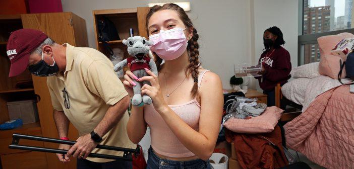 Girl holding Fordham teddy bear