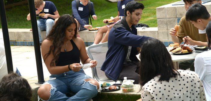 Students eat at picnic