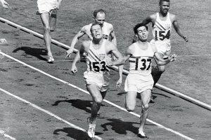 Tom Courtney, no. 153, crossing the finish line for the gold medal in the 800-meter race at the 1956 Olympics in Melbourne.