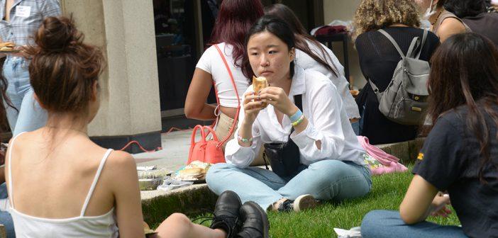 girl holds hot dog