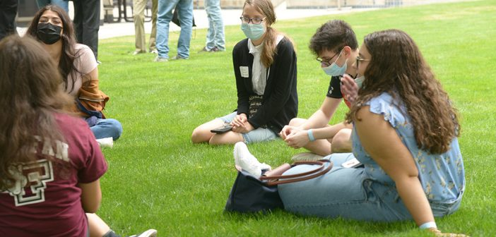 students in breakout groups