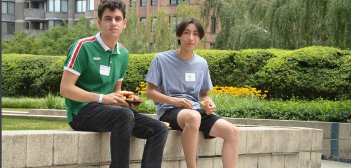 two men pose at picnic