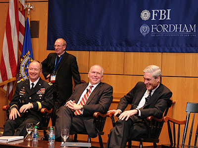 Three of the nation's chiefs of security appeared together for the first time on August 8, 2013, at the fourth International Conference on Cyber Security sponsored by Fordham and the FBI. From left: Gen. Keith Alexander, then head of the NSA; John Brennan, FCRH '77, then head of the CIA; and Robert Mueller, then head of the FBI. Photo by Chris Taggart