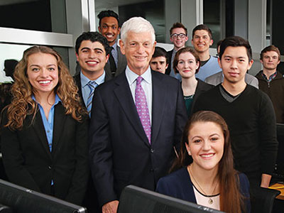 Mario Gabelli with Fordham business students in February 2015. Photo by Bruce Gilbert