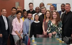 Group picture of Ph.D. students standing together
