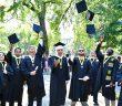 Veteran graduates throw their hats into the air.