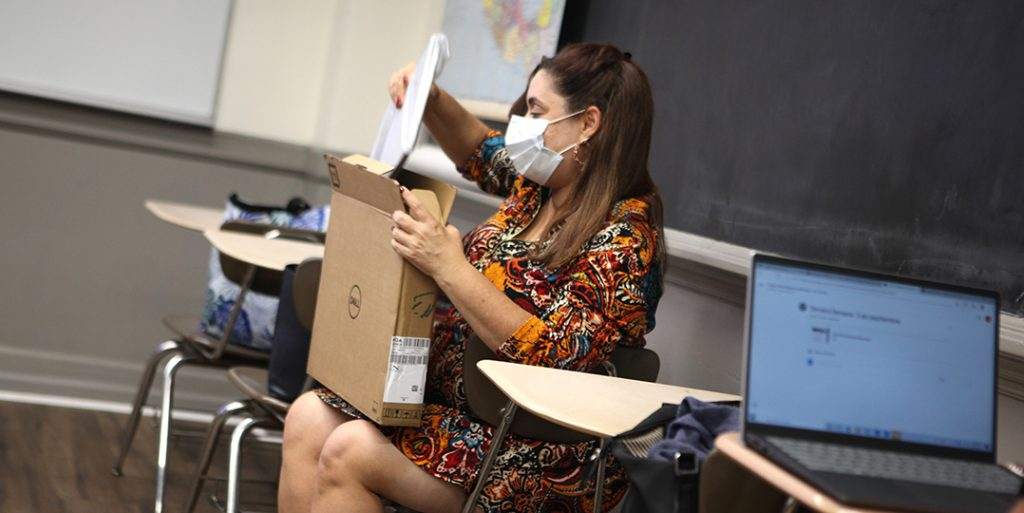 Raysa Veras receives her new computer.