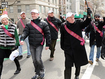 Father McShane marches up Fifth Avenue with Fordham alumni and students in the 2014 St. Patrick's Day parade. Photo by Chris Taggart