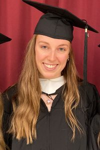 Anne-Sophie Neumeister wearing cap and gown at Fordham's graduation.