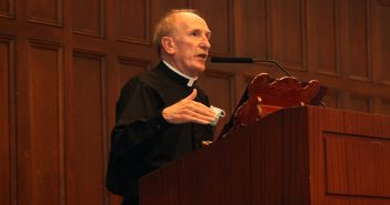 Father McShane delievers the 2021 State of the University address at a wood podium