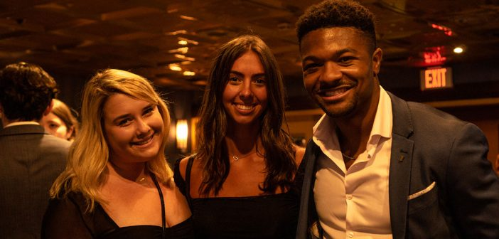 Three recent Fordham graduates on the Young Alumni Yacht Cruise, October 2021