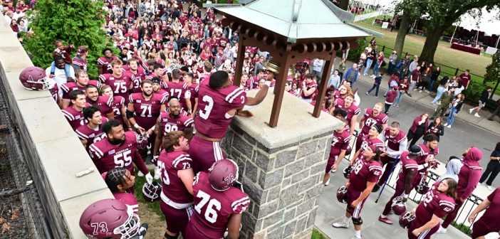 Fordham football players ring the victory bell