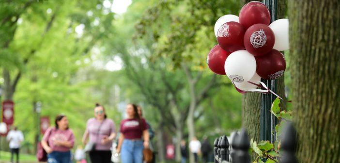 Balloons decorate a sidewalk