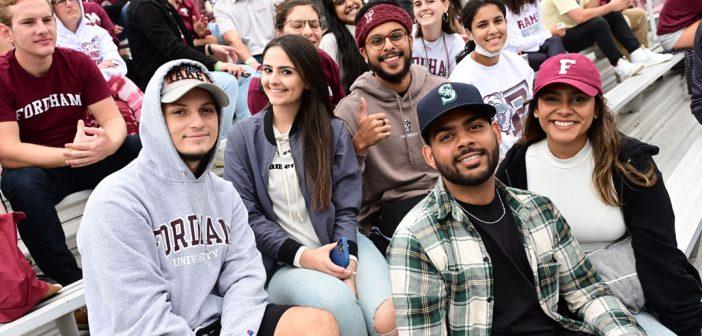 Fans watch a football game